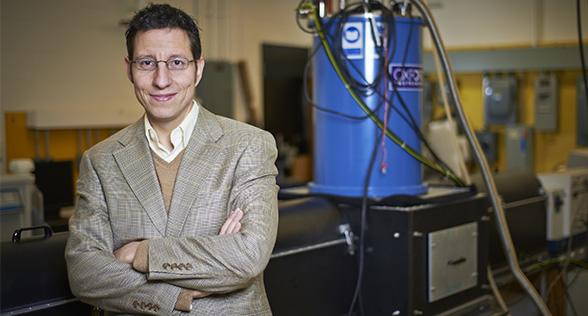 This is professor Pavle Radovanovic in front of the magnetic circular dichroism system used in this study. @ University of Waterloo