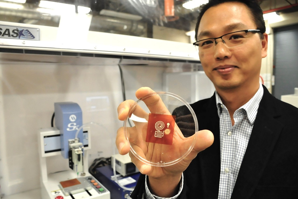 SFU Mechatronic Systems Engineering professor Woo Soo Kim is collaborating with Swiss researchers to develop an eco-friendly 3D printable solution for producing wireless Internet-of-Things sensors. The research team is using a wood-derived cellulose material to replace the plastics and polymeric materials currently used in electronics. @ SFU