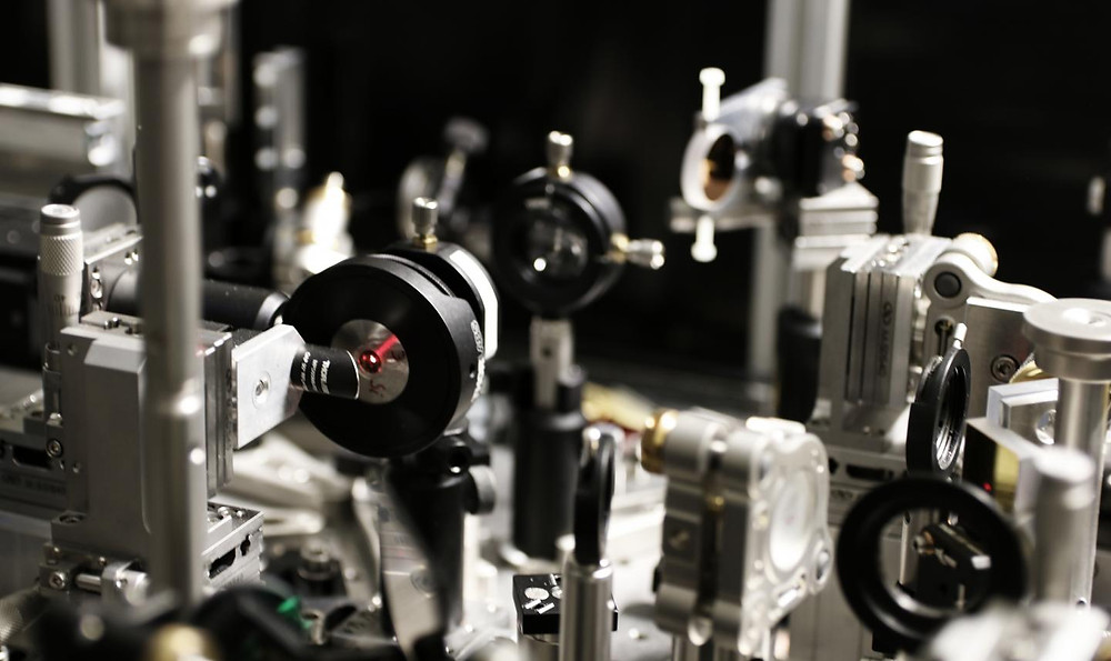 This is a close-up of the experimental setup in the University of Konstanz's high-field Terahertz lab. Under the extreme conditions of the experiment, a bright red glow can be seen to emanate from the gallium arsenide crystal used as a semiconductor. This is due to the system's extremely high optical nonlinearity, which occurs when Wannier-Stark localization sets in. @ Leitenstorfer research team