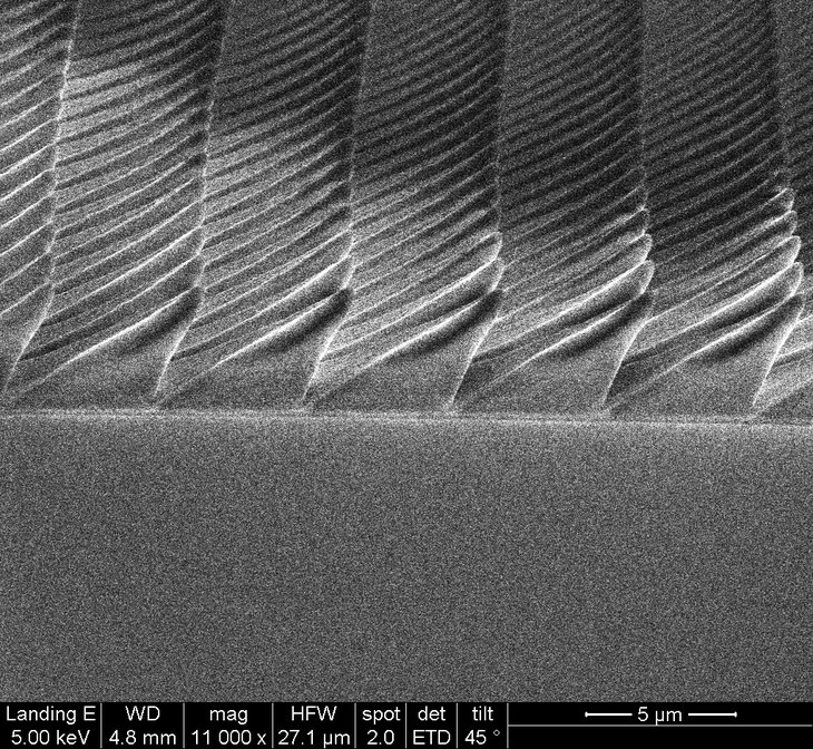 Saphire surface with asymmetrical pyramids to produce more light in LEDs.  @ Yin Lab/ Penn State
