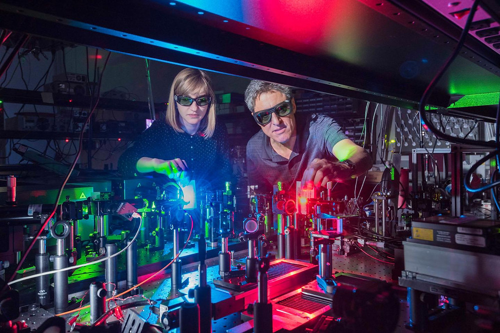 Sandia National Laboratories postdoctoral appointee Polina Vabishchevich, left; and Senior Scientist Igal Brener made a metamaterial that mixes two lasers to produce 11 colors ranging from the near infrared, through the colors of the rainbow, to ultraviolet. Research on the new light-mixing metamaterial was published in Nature Communications earlier today. @ Randy Montoya