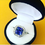 Tanzanite set in 18ct Yellow Gold with Diamond Halo Setting in 18ct White Gold