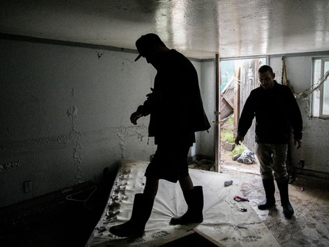 Jonathan Robert Von Renner Jr. (left) and Homer Mitchell check out the damage to the first floor of their home along Mill Street after floodwaters submerged the entire floor in Guerneville, Calif. Thursday, Feb. 28, 2019.