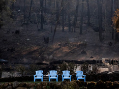 A line of untouched blue chairs sit neatly against a charred hillside along Sanitarium Road in Deer Park, Calif. Tuesday, September 29, 2020. The Glass Fire has burned more than 42,000 acres by Tuesday morning and is 0% contained.