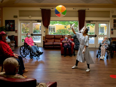 An employee wears full personal protective equipment while leading an exercise with a group of socially distanced residents at Gordon Manor assisted-care facility in Redwood City, Calif. Tuesday, June 30, 2020. Early in the pandemic, one person had tested positive for COVID-19 at Gordon Manor  where Alisa Tu is the administrator, and most of the staff had stopped showing up to work out of fear of contracting the virus. Soon, most of the residents of the facility had the virus and 12 people would ultimately die. What followed is aggressive action by the county. Dr. Ryan Azcueta, a doctor who responded to the Life and Care Center of Kirkland nursing home in Washington, set up triage and now, nearly a month after a catastrophe, the facility is COVID-free.