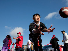 Dylan Nguyen, 14, of Milpitas catches a football while tailgating ahead of a NFC Divisional Playoff game between the San Francisco 49ers and Minnesota Vikings held at Levis Stadium in Santa Clara, Calif. Saturday, Jan. 11, 2020.