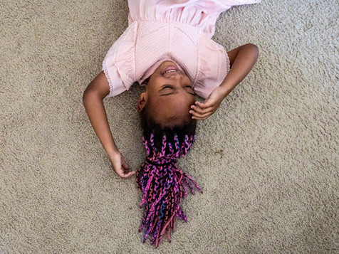 Zahra Trimnell, 5, lies on the floor while her mother, Cassandra Trimnell, 31, gets her ready for school while at home in San Jose, Calif. Friday, September 20, 2019. Trimnell lives with sickle cell disease and founded a non-profit to promote awareness of sickle cell.