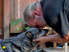 Allen Strong of Ben Lomond comforts his 10-year-old blind dog Annie while camped out at La Placa Family Bakery in the evacuation zone of Ben Lomond, Calif. Thursday, August 27, 2020. Strong and his friend Brent White have remained in town, spending the night at the La Placa Family Bakery to keep an eye on it for the Placa family. Residents in the communities of Ben Lomond, Boulder Creek, Last Chance, Swanton and Felton are still under evacuation orders as the CZU Lightning Complex Fire continues to burn in the Santa Cruz Mountains.