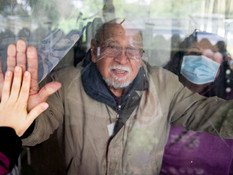Putting my hand up to the window to say goodbye to my grandpa and mom during a short visit to her house in Sunol, Calif. Monday, April 6, 2020.