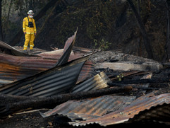 Cal Fire Damage Inspection crewmember Carlos Hernandez assesses the damage to a destroyed woodshop along Highway 128 in Healdsburg, Calif, Tuesday, October 10, 2019 after a handful of buildings were destroyed on Hank Wetzel's peoperty by the Kincade Fire.