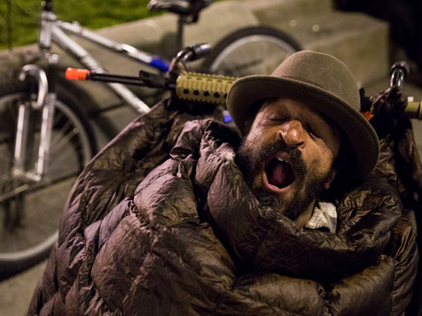 Alex Piersen, also known as Shorty, yawns while bundled up in multiple jackets and sleeping bag along the Embarcadero in San Francisco, Calif. Wednesday, June 19, 2019.