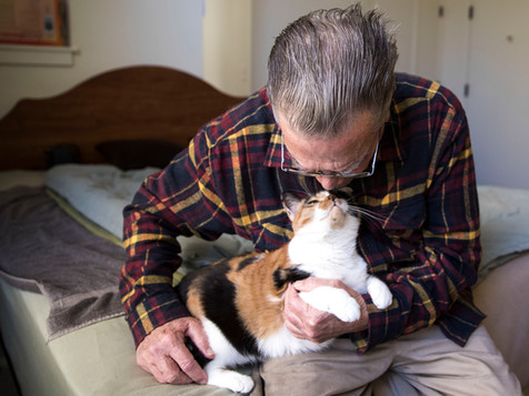 Wayne Shannon, 74, lovingly holds his cat, Girlie, while inside his studio apartment at The Altenheim senior living facility in Oakland, Calif. Monday, Feb. 18, 2019.