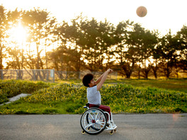 Garnett Silver-Hall, 18, practices his shooting game with his mother's partner Lee Tafari at Mesa Park in Bolinas, Calif. Friday, April 3, 2020. The Coronavirus pandemic and accompanying shelter-in-place forced Garnett's school to close its campus at the same time that his sled hockey and basketball teams cancelled their seasons for the year. With more down time, Garnett spends every evening working on his basketball skills on the local courts.