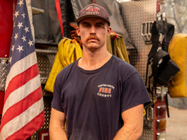 Contra Costa County firefighter James Myers poses for a portrait after working a 36 hour shift to successfully protect structures from the Glass Fire at Stony Hill Vineyard in St. Helena, Calif. Thursday, October 1, 2020. Fire crews from Contra Costa County, Moraga-Orinda and Rodeo-Hercules fire departments worked through Wednesday day and night to protect structures at Stony Hill Vineyard and were successful, although the surrounding property suffered fire damage. The Glass Fire has burned more than 56,000 acres in Napa and Sonoma counties by Thursday morning and is 5% contained.