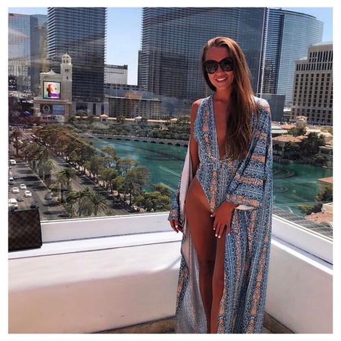 9543ade5acc66 Make sure your looking glam this summer in this blue snakeprint swimsuit  and matching kimono. Featuring a low plunge swimsuit with a high cut sides  and ...
