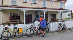 Cycle group outside old hotel