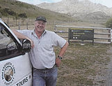 smiling-tour-guide-beside-vehicle-at-ent