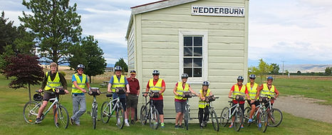 Cyclist's standing beside the former Wedderburn station building
