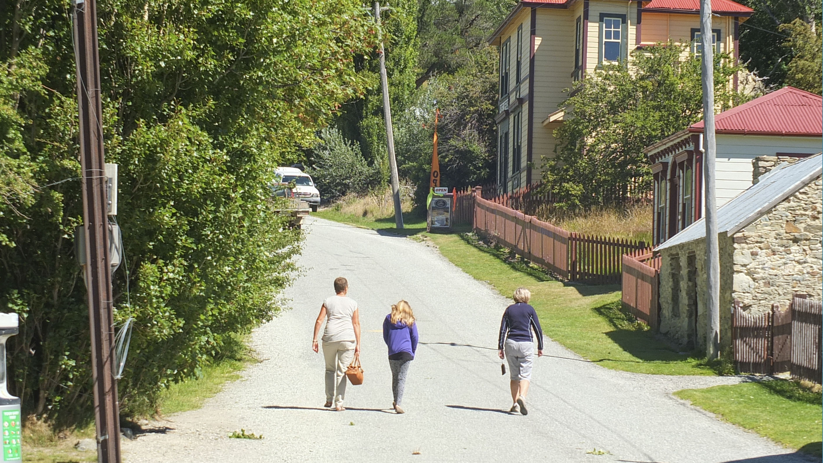 family-walking-through-small-country-settlement