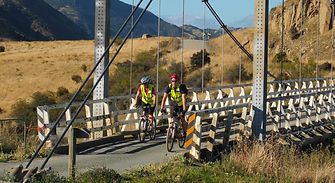 cyclists-riding-across-old-truss-bridge-