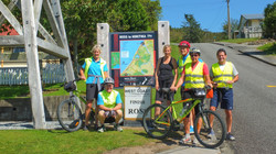 Cycle tour group standing on road