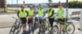 Cycle tour group standing on side of road at the start of ride