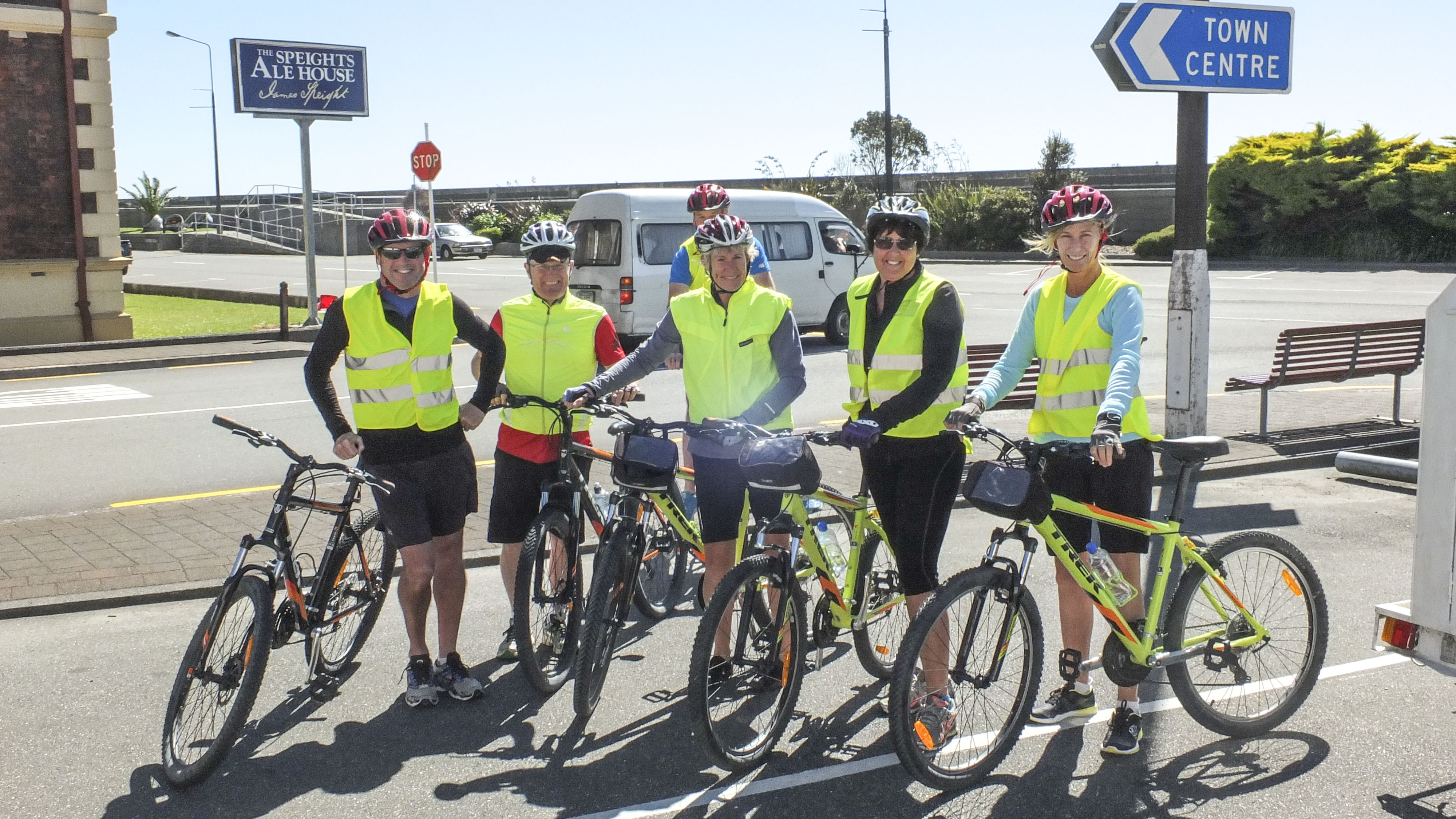 Cycle group standing beside sign