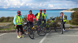Cyclists standing  on the foreshore