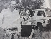 smiling-couple -standing-in-front-of-4wd