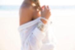 Model wearing beach jewellery bracelets by Divine Creatures, Rainbow Bay, Australia
