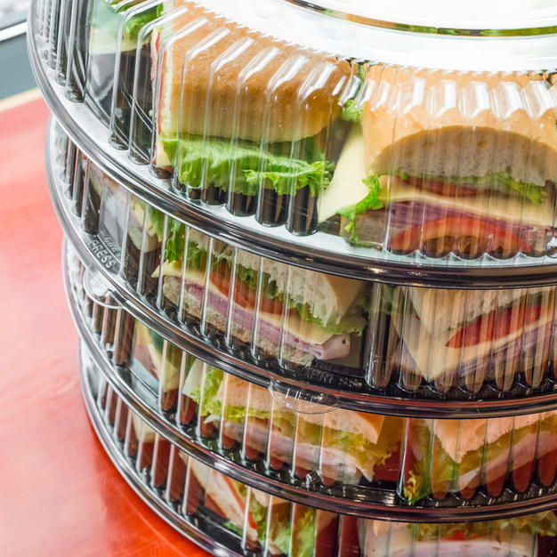 Trays of sandwiches cut in a half