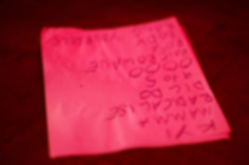 A close-up of the vibrant, neon pink setlist