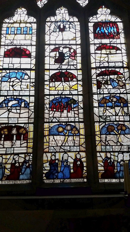One of the many stained glass windows at All-Saints. This one is in three sections, showing many religious scenes.