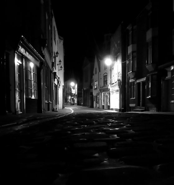 """A photograph of Church Street in Whitby. Taken from just above the cobblstone street, this image became the background for the illustration of """"Addictions"""" in Tales in Sombre Tones."""