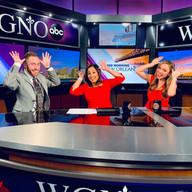 Speading Christmas Cheer on the anchor desk.