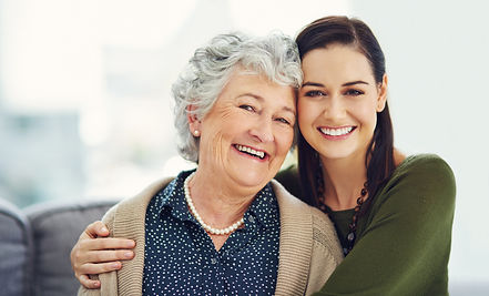 Happy elderly person with support worker. Home care.