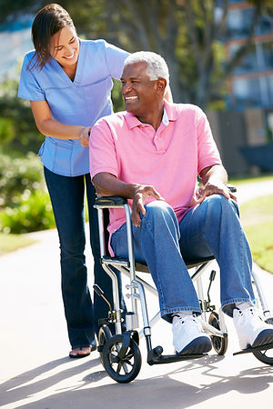 Happy person in a wheelchair. Home care.