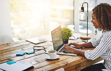 Woman using BookJane Agency on laptop.