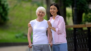 Happy, independent elderly lady with a caring support worker.