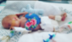 Tara's son using his Snuggle Heart in th