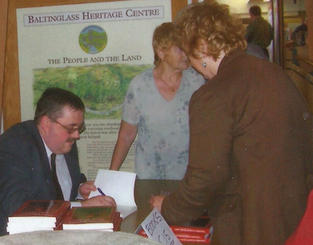 Chris signing books at the launch of
