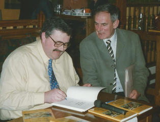 Chris signing a book at the launch of