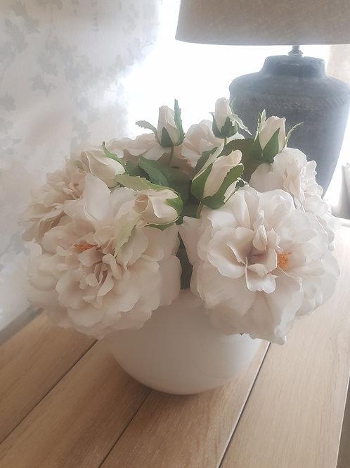 White bobble pot with rose arrangement