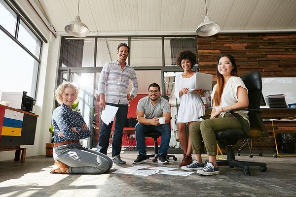 team-of-creative-people-in-office-PKWNTE