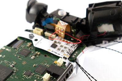 ps5_programmierbarer_remapper_chip_programmable_remap_board_installed.jpg
