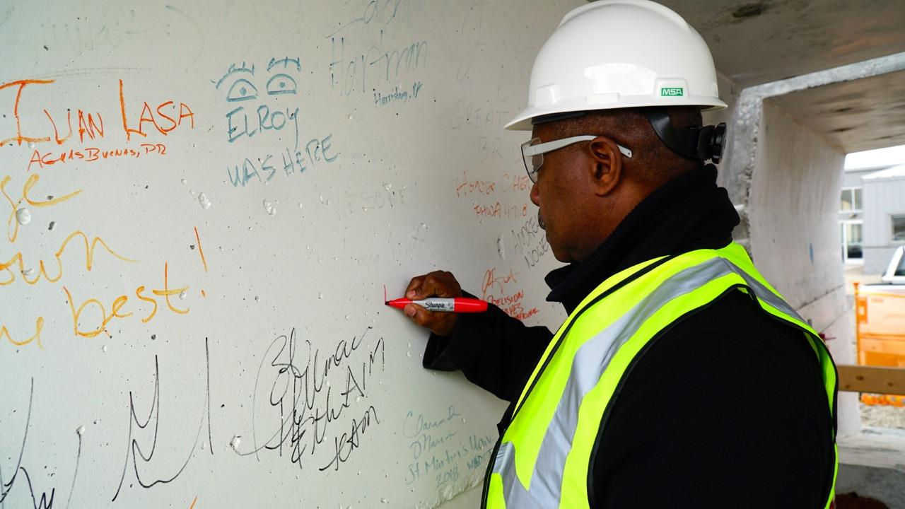 Mayor Copeland signs a bridge segment.