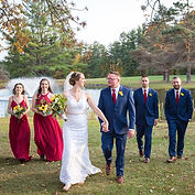 Bride & Groom walking with Wedding Party