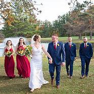 Bride & Groom walking with Wedding Party