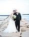Bride & Groom posing on rocks at beach