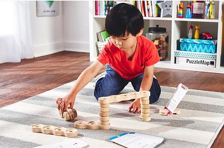 Osmo Asian Child on Floor.JPG